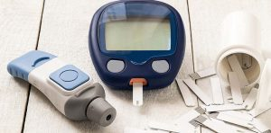 A type of glucose meter is on a table