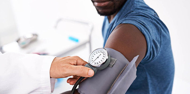 A man is having his blood pressure checked