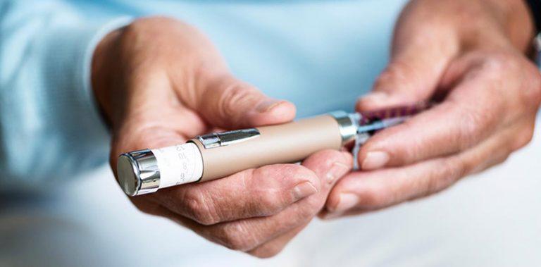 A diabetic holds an insulin pen